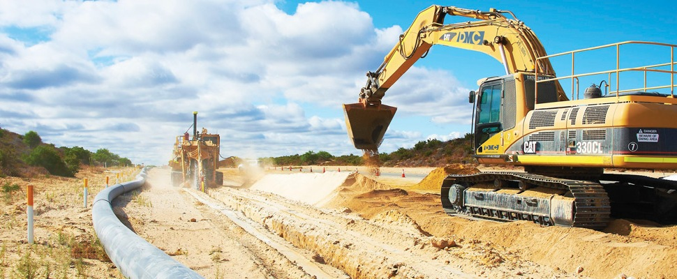 DM Civil contractors excavator laying pipelines