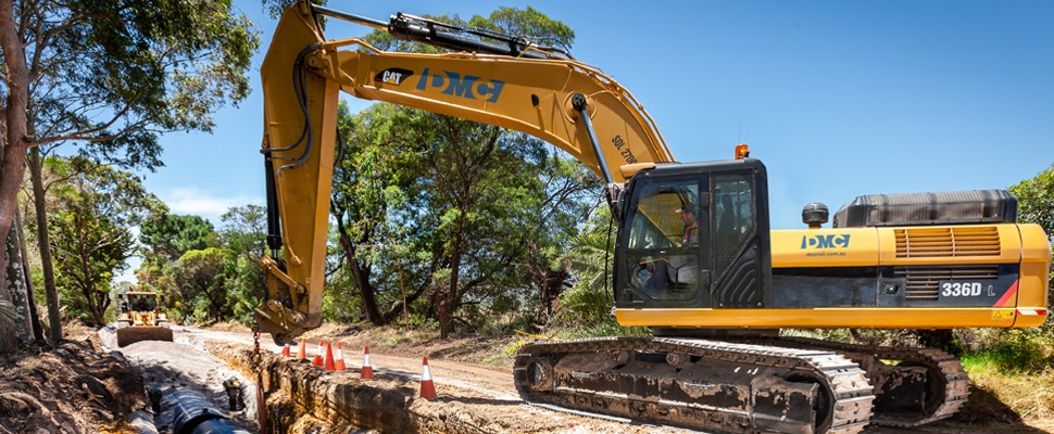 DM Civil Contractors Perth  - excavator laying pipeline